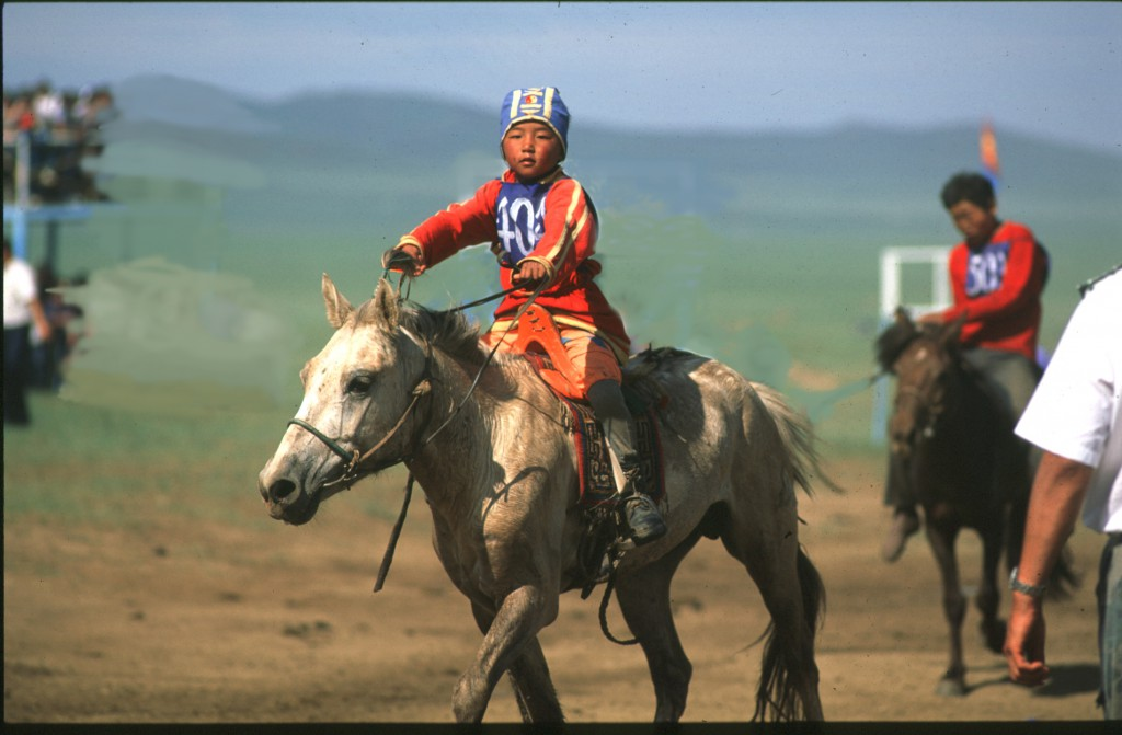 Mongolian boy on horse