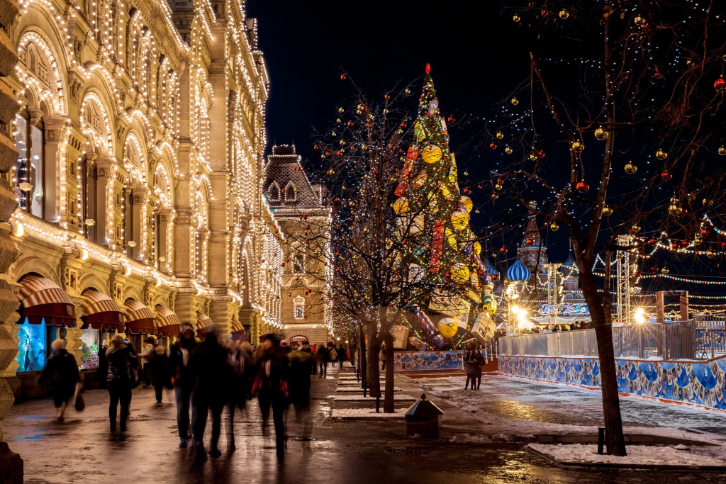 MOSCOW, RUSSIA - DECEMBER 17, 2015: People on Christmas market on Red Square, decorated and illuminated for Christmas in Moscow, Russia