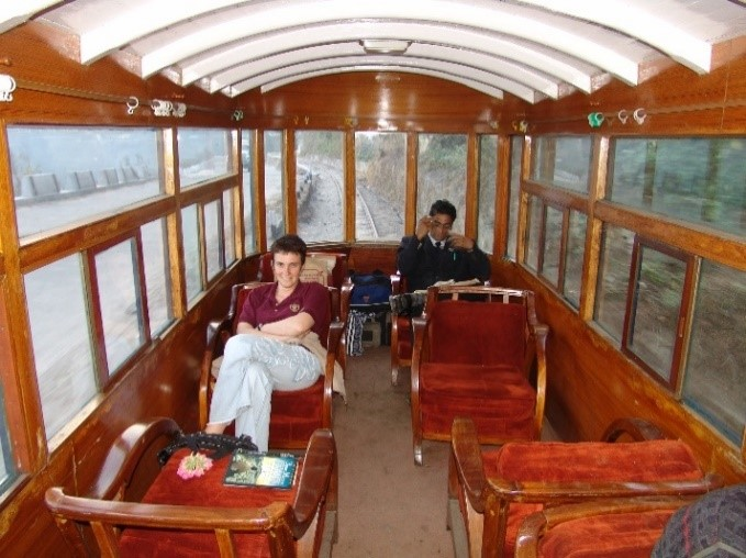 Marina in an observation car on the railway in Darjeeling, India