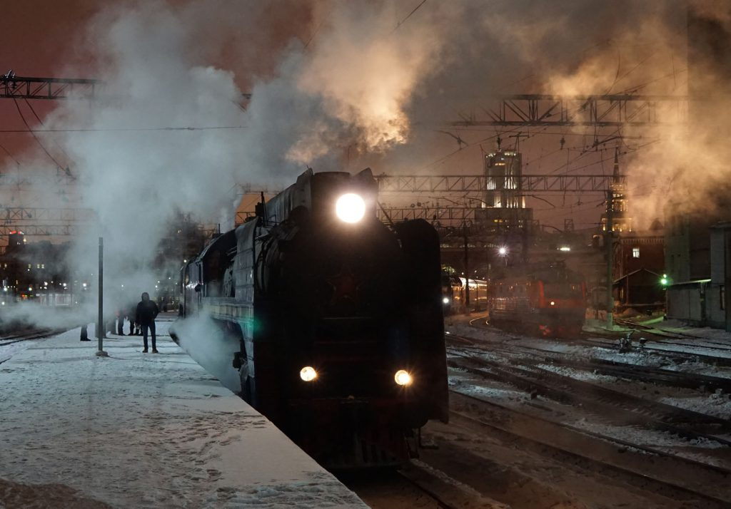 Golden Eagle train at Moscow Kazansky Station, hauled by steam engine.