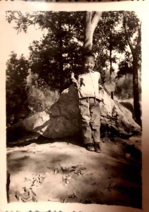 A young boy holding the American flag