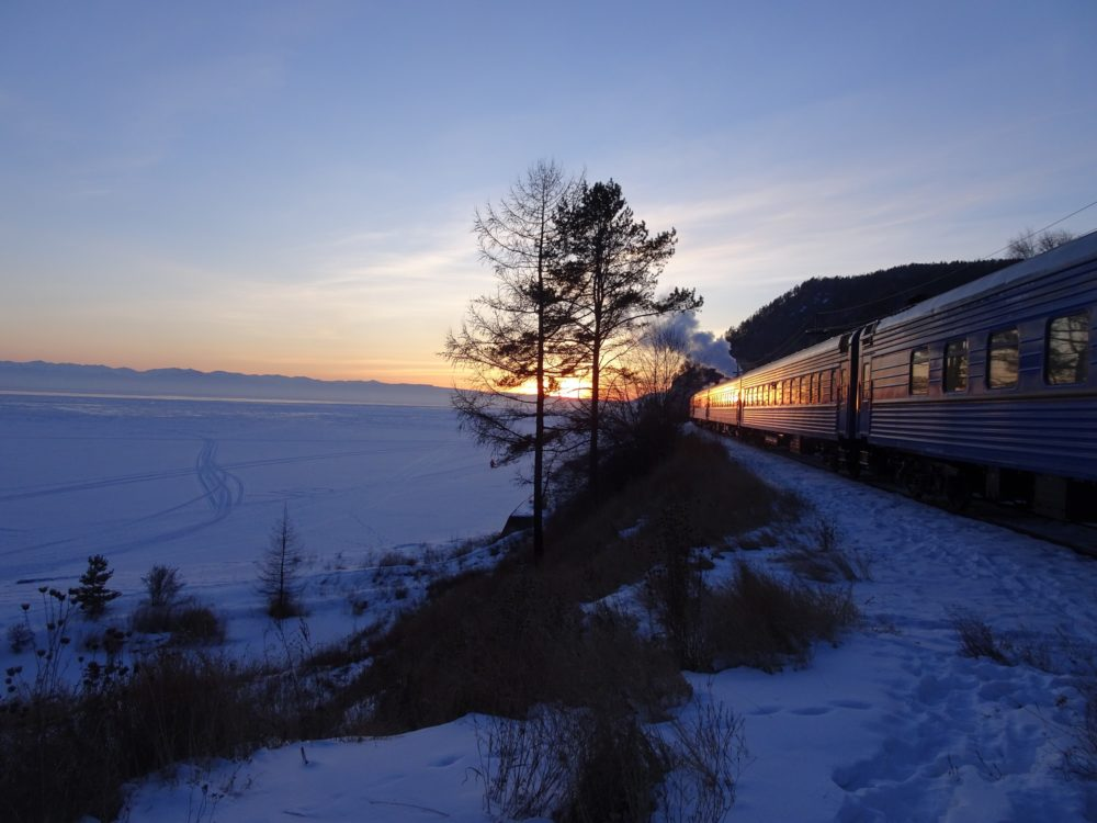 A sunset at Lake Baikal with a steam engine