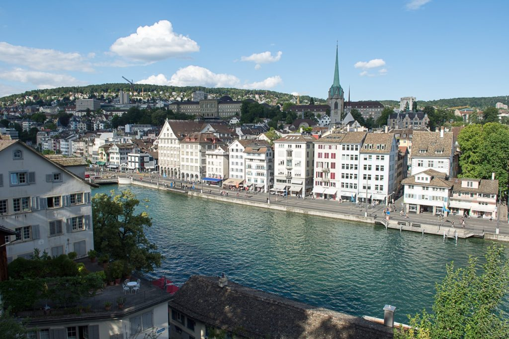 A view of Zurich along the riverbank.