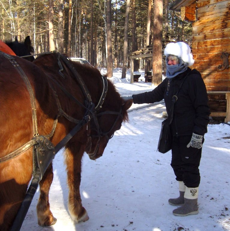 Our Guest Speaker in winter gear with troika horses